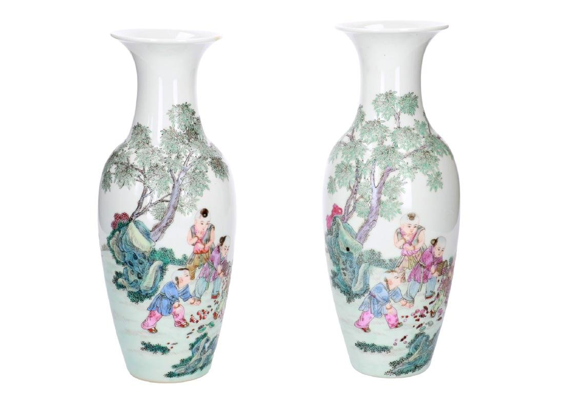 A pair of polychrome porcelain vases, decorated with