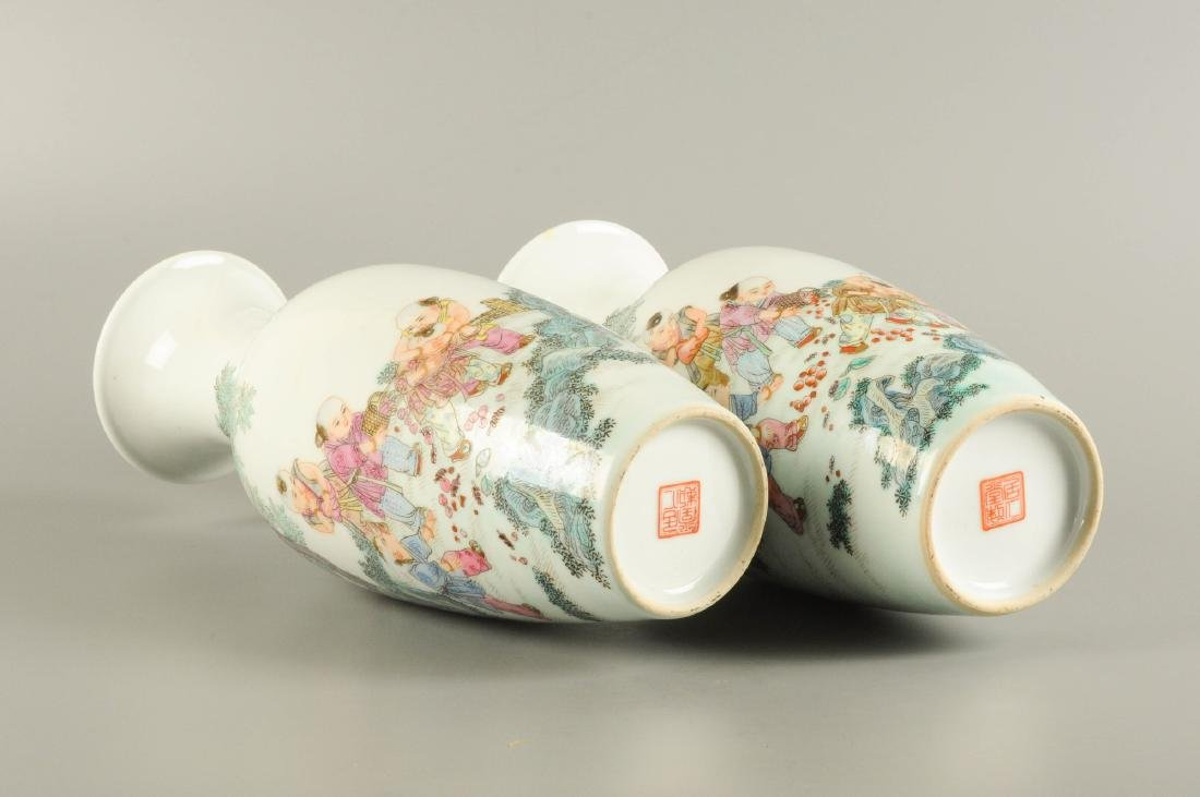 A pair of polychrome porcelain vases, decorated with - 2