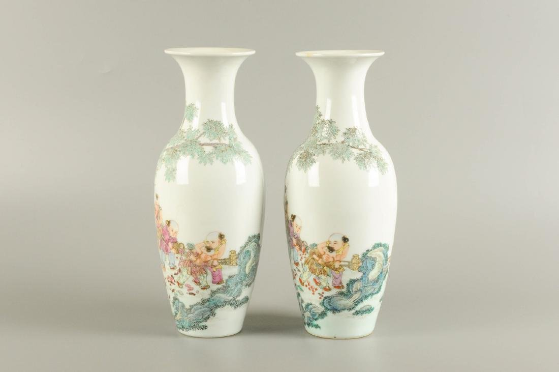 A pair of polychrome porcelain vases, decorated with - 3