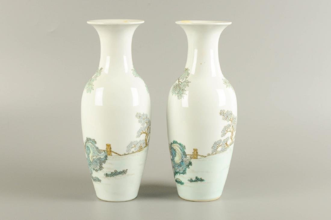 A pair of polychrome porcelain vases, decorated with - 4