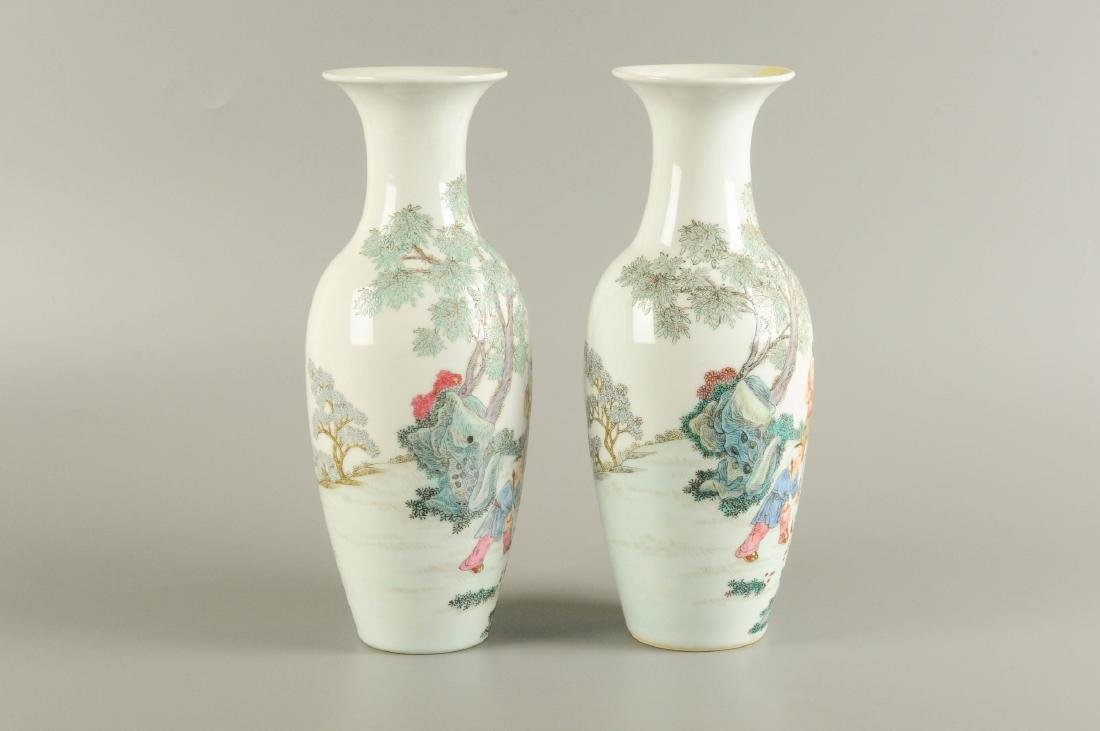 A pair of polychrome porcelain vases, decorated with - 5