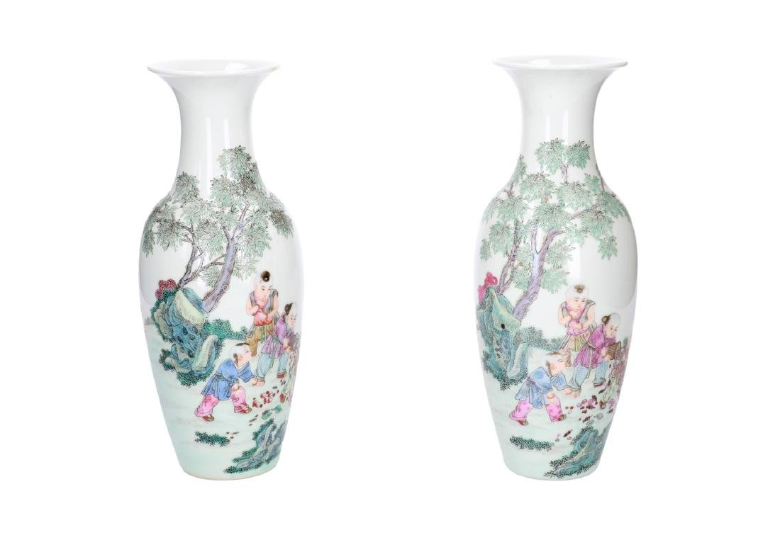 A pair of polychrome porcelain vases, decorated with - 6