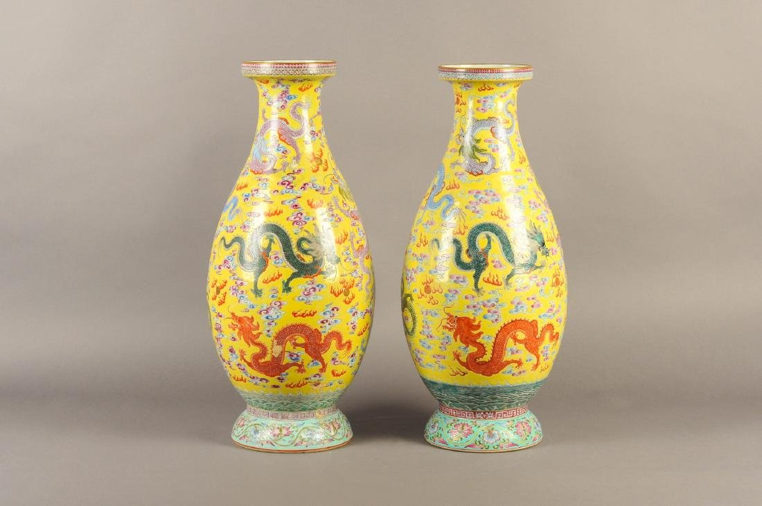A pair of polychrome porcelain vases with a decor of