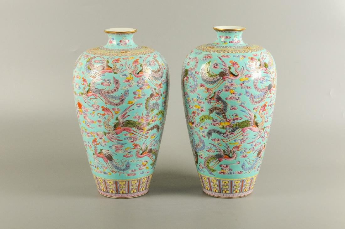 A pair of polychrome porcelain Meiping vases, decorated