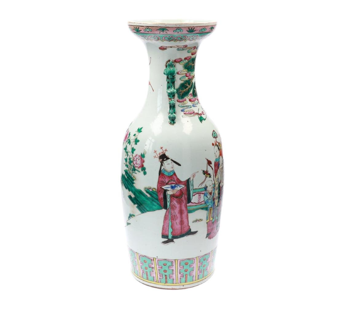A lot of two polychrome porcelain vases, decorated with - 11