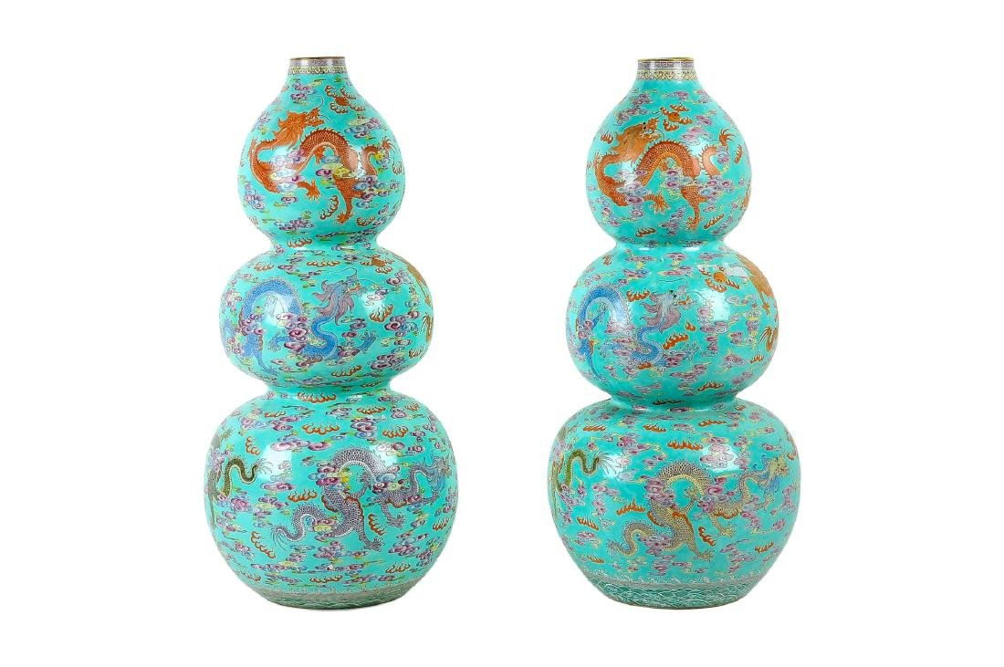 A lot of two triple-gourd polychrome porcelain vases,