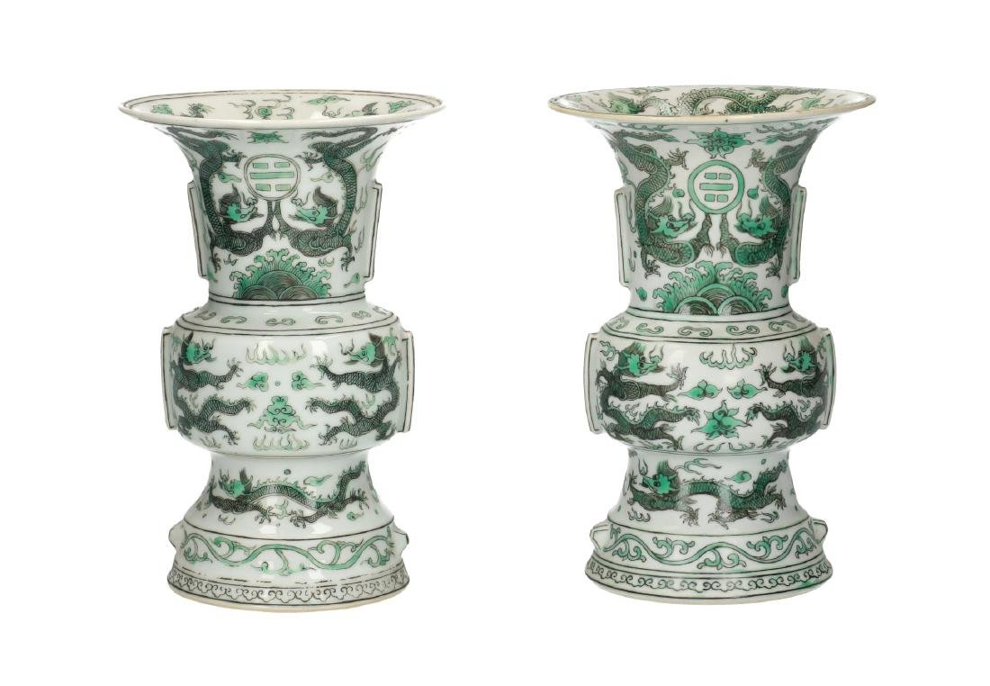 A lot of two polychrome porcelain vases, decorated with