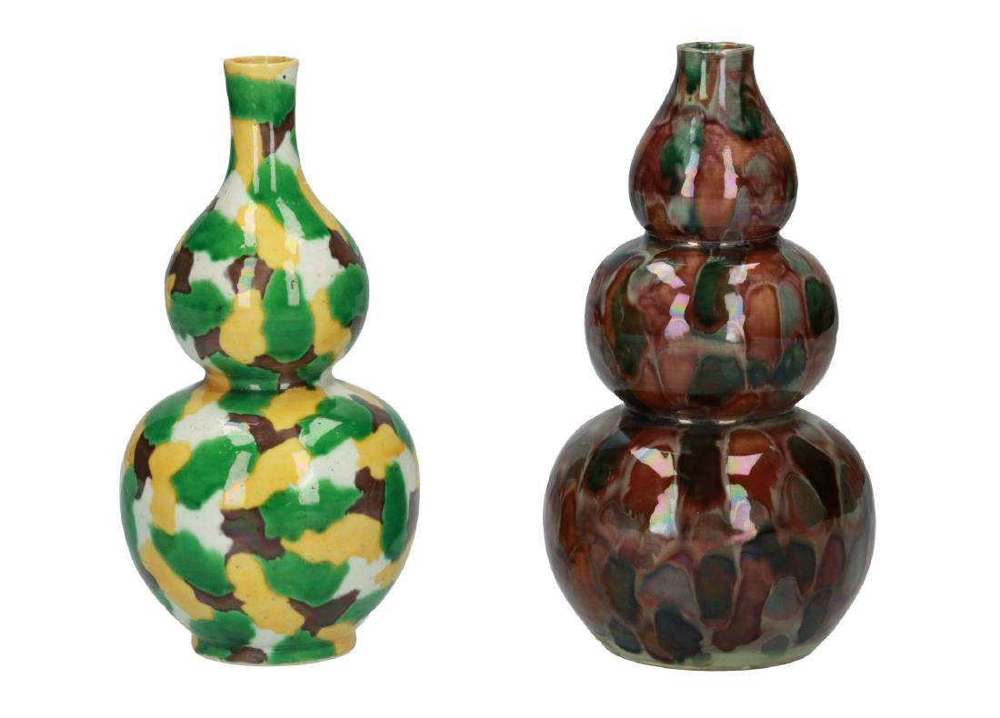 A lot of two polychrome porcelain vases, one with