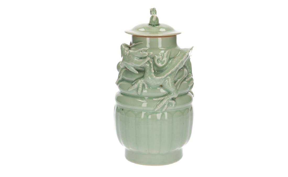 A lot of three celadon lidded vases, decorated with - 12