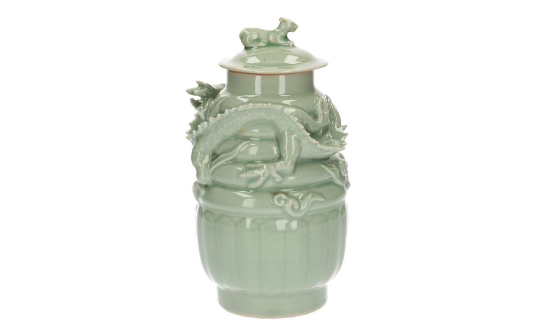 A lot of three celadon lidded vases, decorated with - 13
