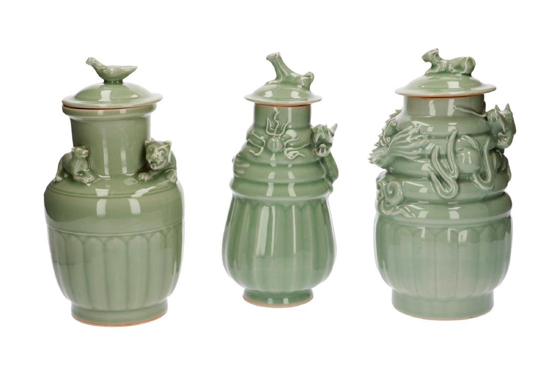A lot of three celadon lidded vases, decorated with