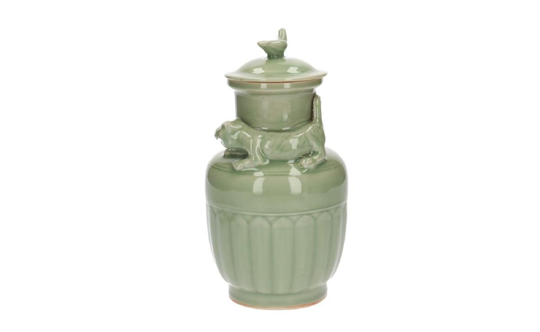 A lot of three celadon lidded vases, decorated with - 2