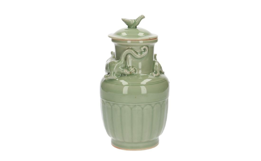 A lot of three celadon lidded vases, decorated with - 3