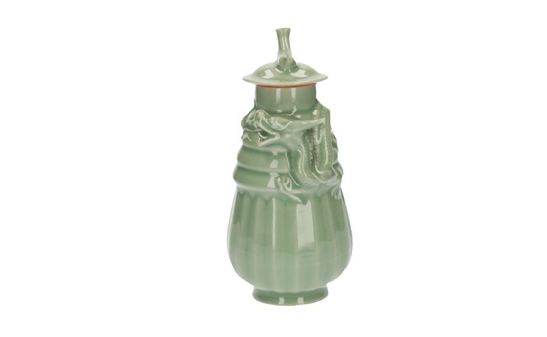 A lot of three celadon lidded vases, decorated with - 7