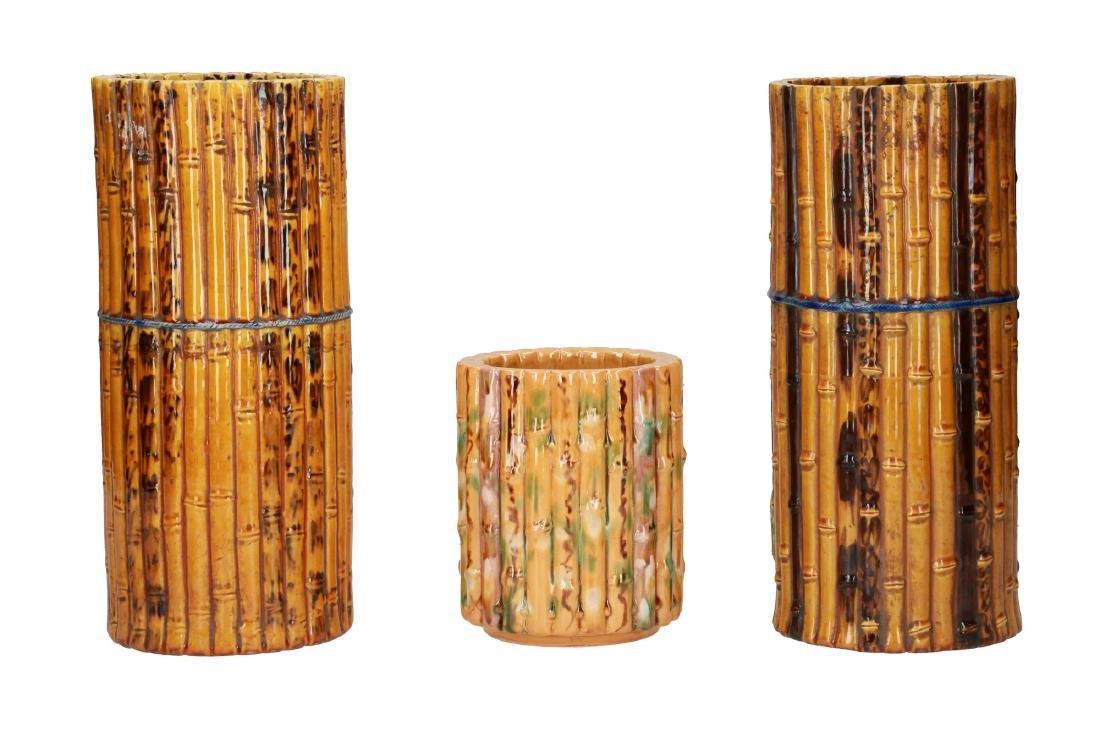 A lot of three stoneware bamboo shaped brush pots.