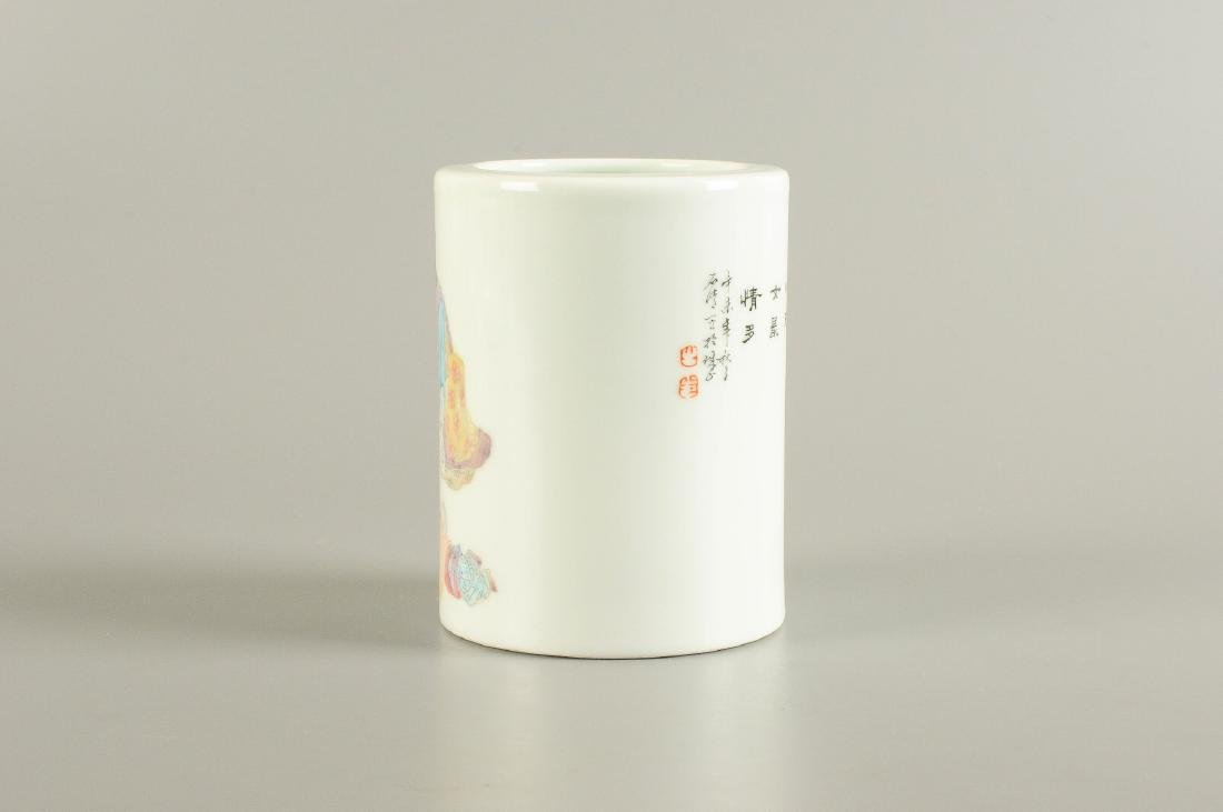 A polychrome porcelain brush pot, decorated with a - 4