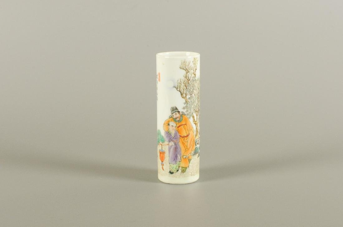 A cylindrical shaped polychrome porcelain brush pot,