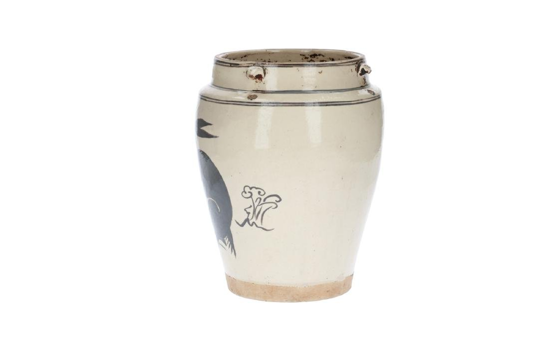 A white and iron brown glazed jar, decorated with a