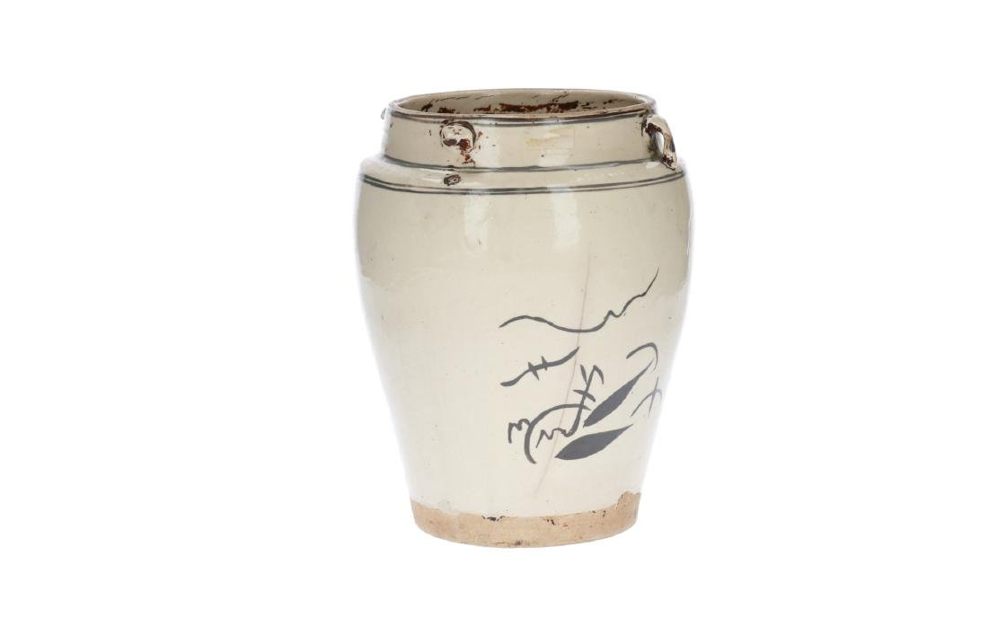 A white and iron brown glazed jar, decorated with a - 2