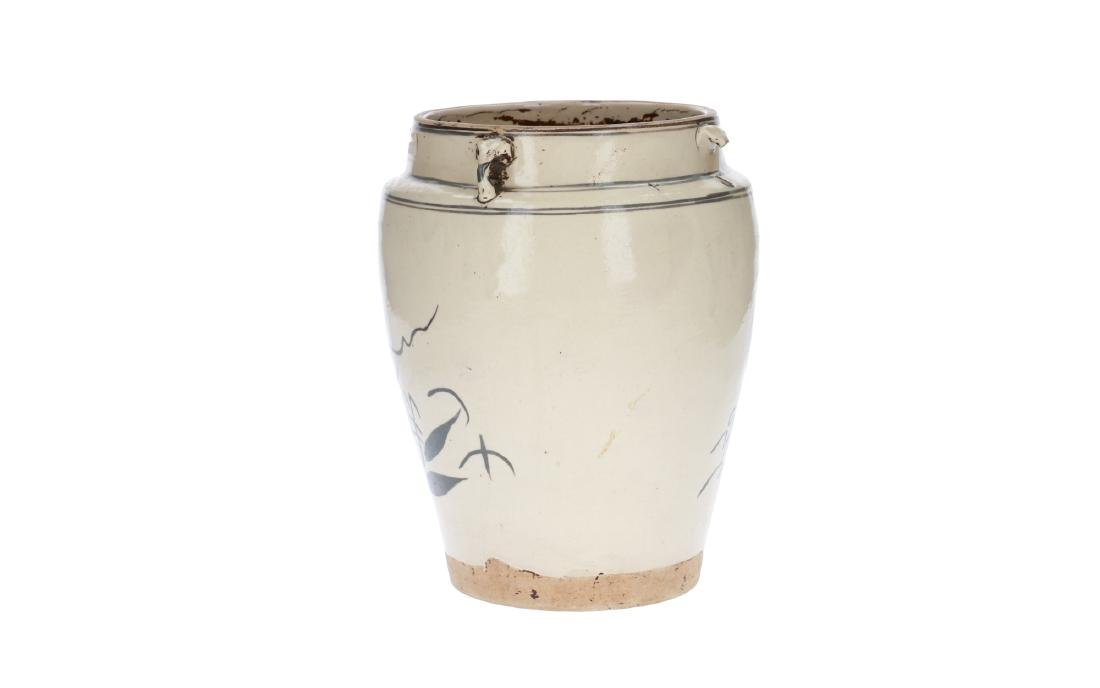 A white and iron brown glazed jar, decorated with a - 3