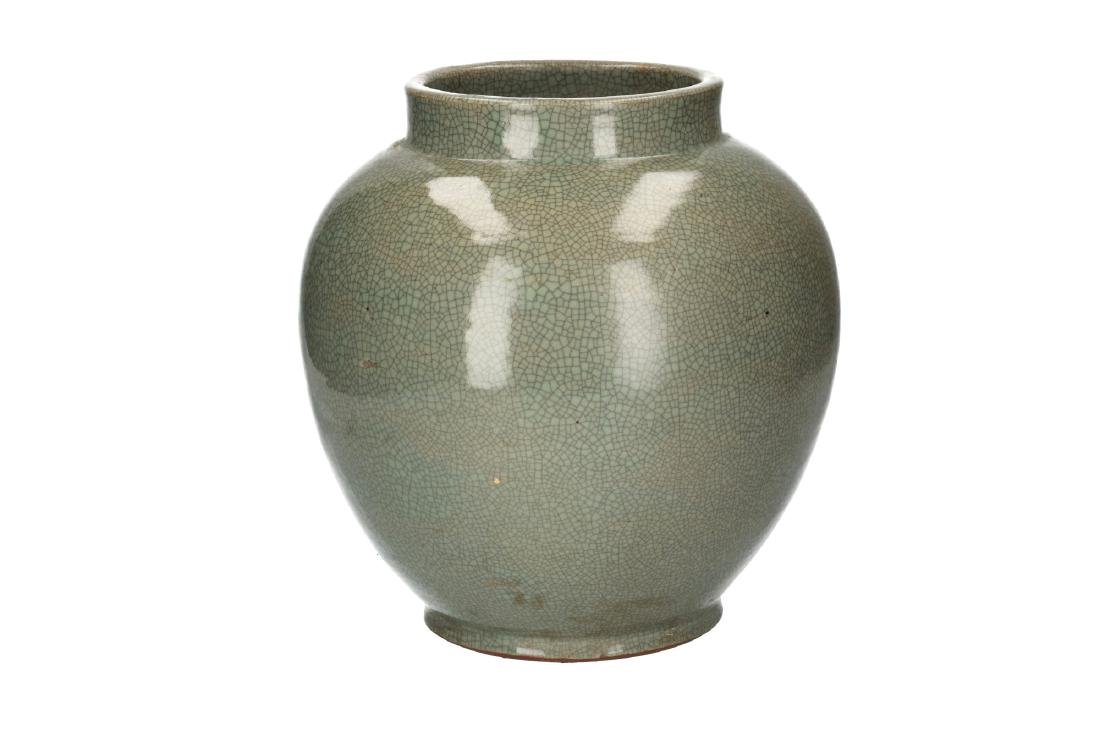 A celadon glazed vase. Unmarked. China, 20th century.