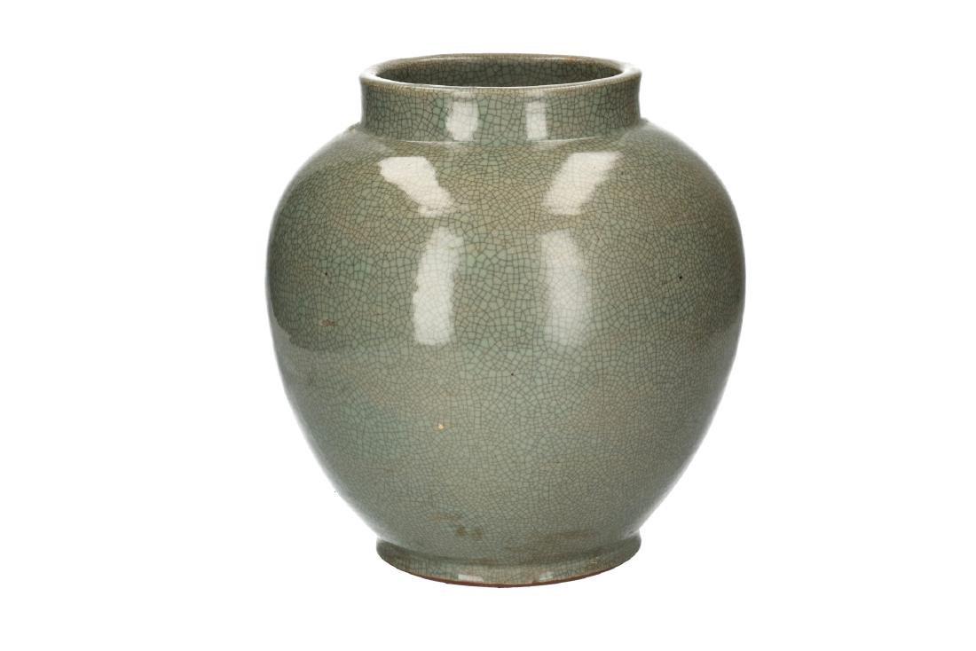 A celadon glazed vase. Unmarked. China, 20th century.
