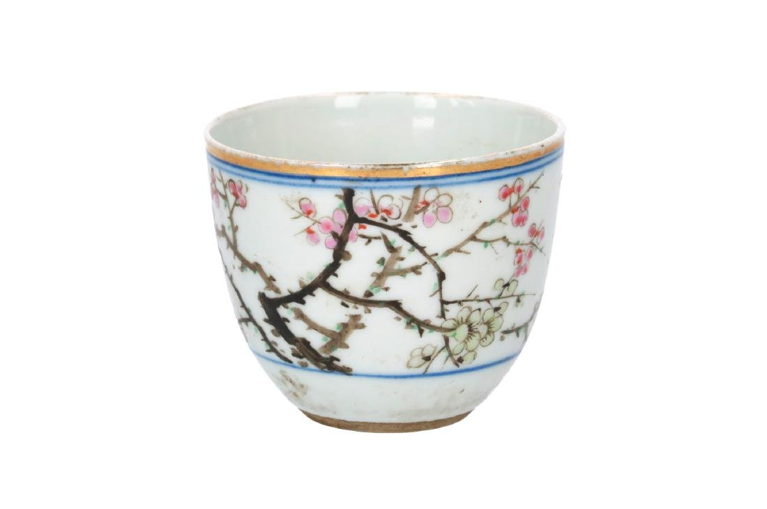 A polychrome cup, decorated with flowers and