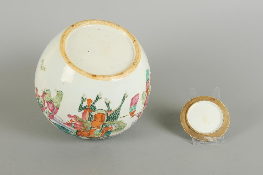 A polychrome porcelain lidded jar, decorated with