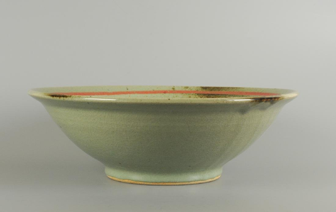 A large polychrome ceramic bowl with floral decor.