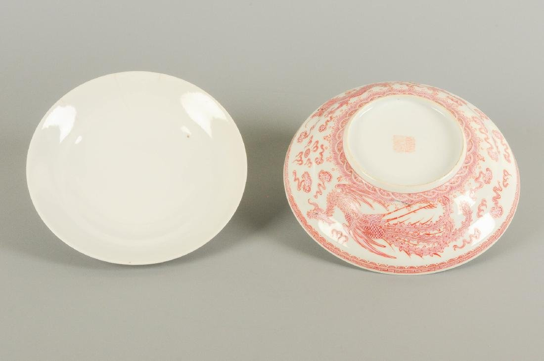 A red and white porcelain bowl with cover, decorated