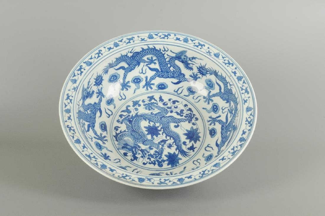 A blue and white porcelain large bowl, decorated with - 4