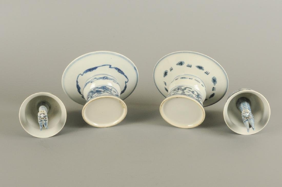 A pair of blue and white porcelain dragon puzzle cups