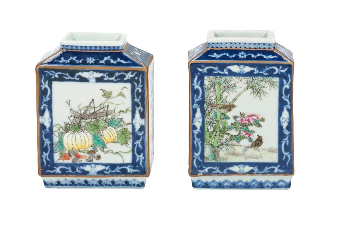 A pair of polychrome miniature vases decorated with