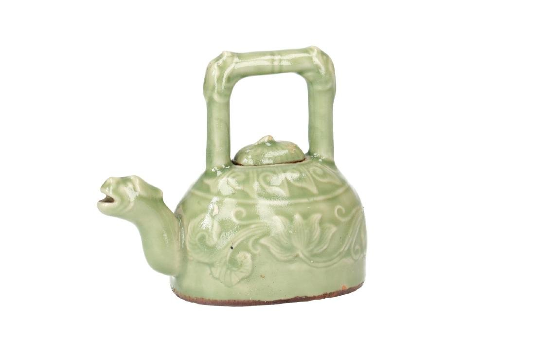 A celadon stoneware teapot. The spout in the shape of - 4