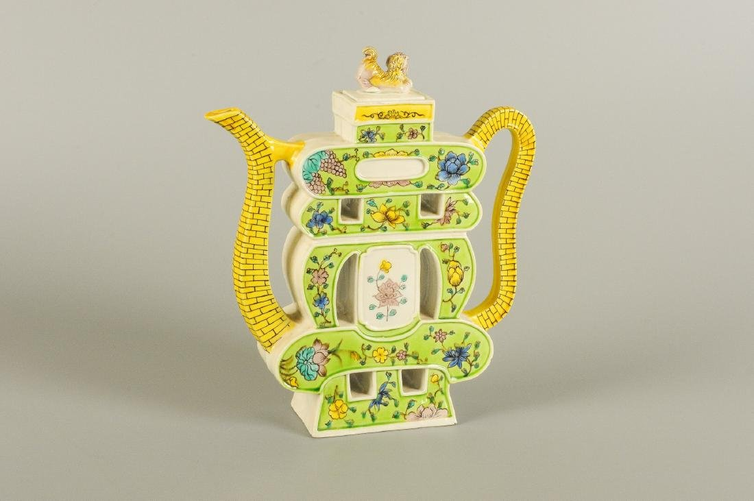 A polychrome porcelain covered ewer with a pierced-work
