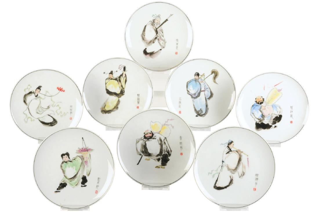 A set of eight polychrome porcelain dishes, decorated