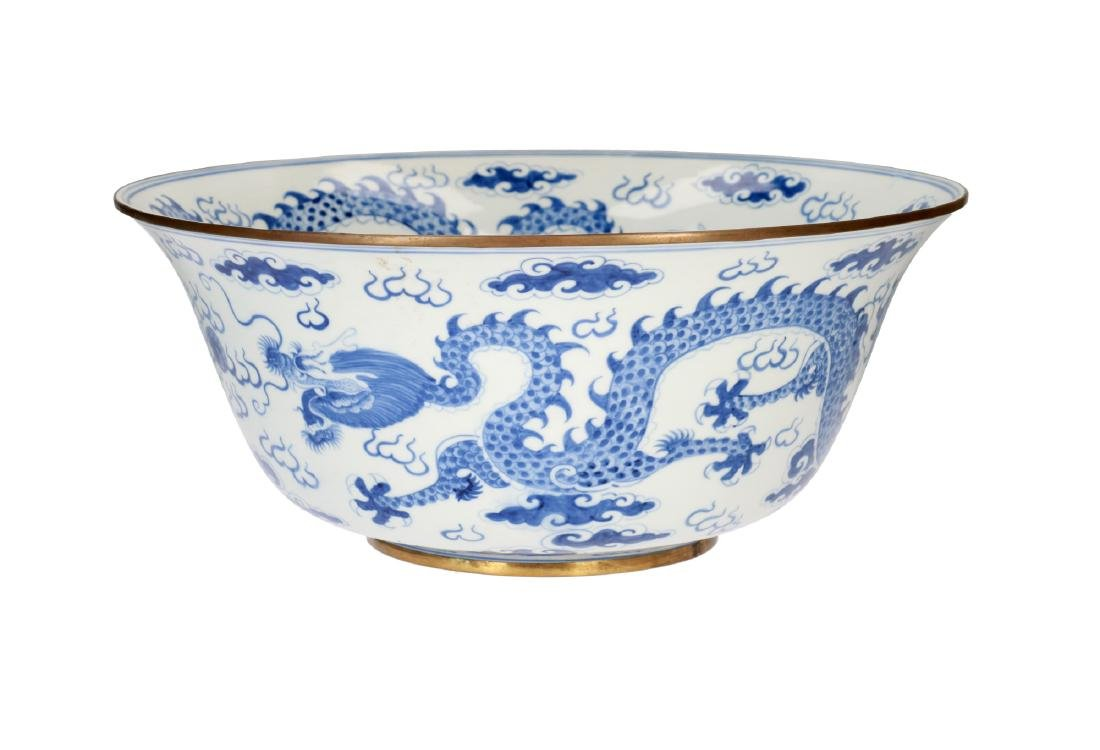 A large blue and white porcelain bowl with metal mount,