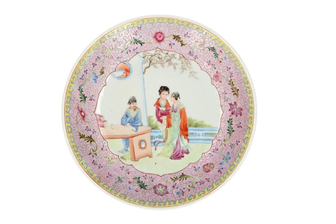 A polychrome porcelain plate, decorated with figures