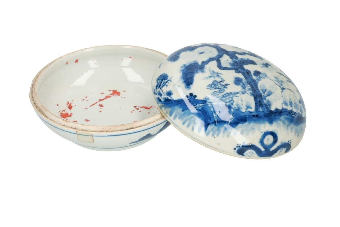 A blue and white porcelain lidded box, decorated with a