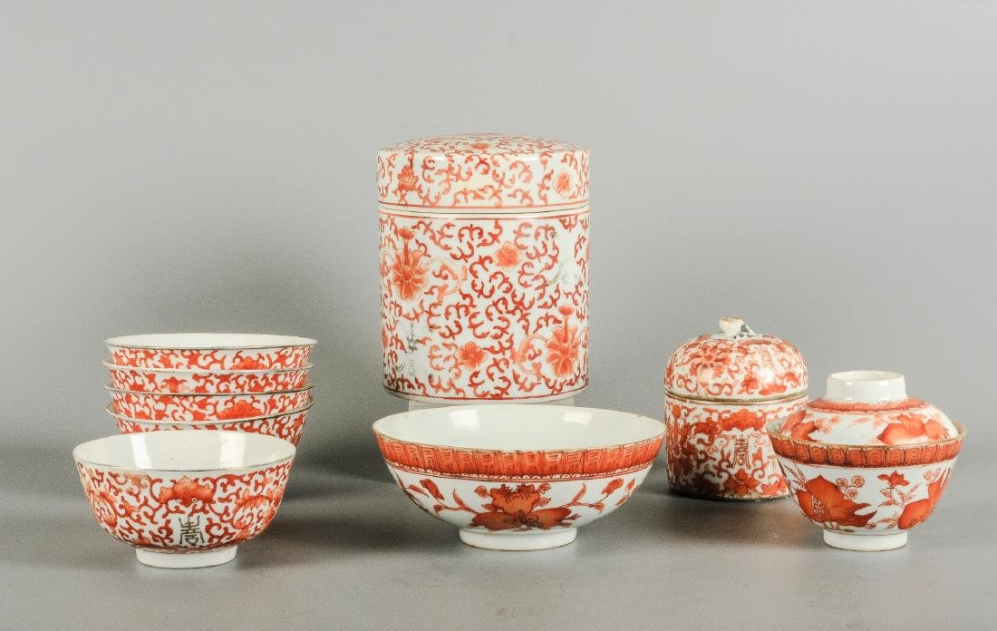 A lot of nine iron red porcelain objects with floral