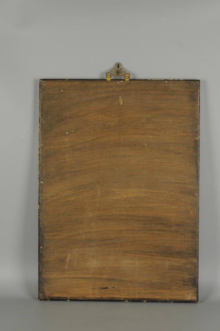 A polychrome porcelain plaque in wooden frame,