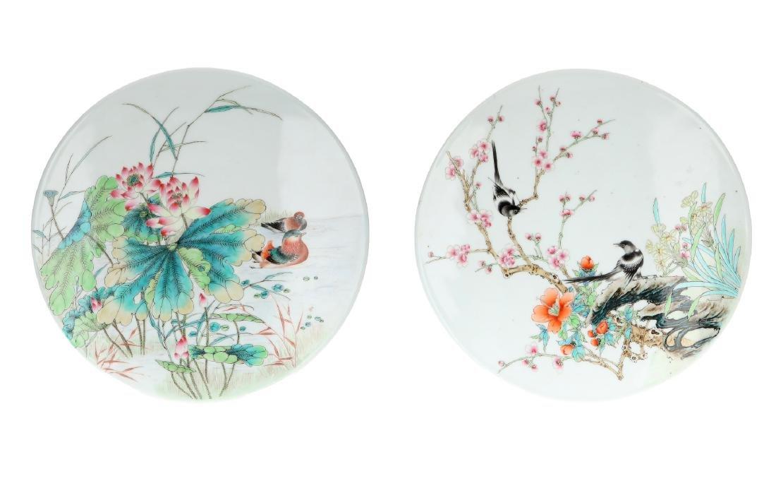 A pair of polychrome porcelain medallion plaques,