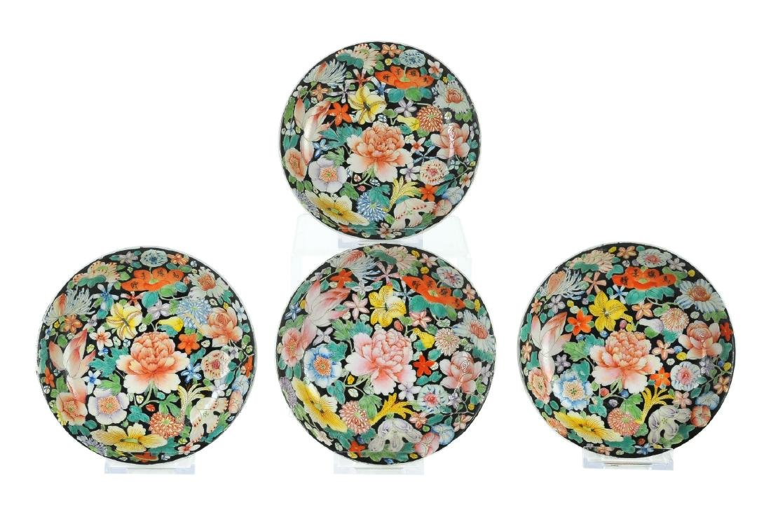 A set of four Mille Fleurs porcelain saucers. Signed in
