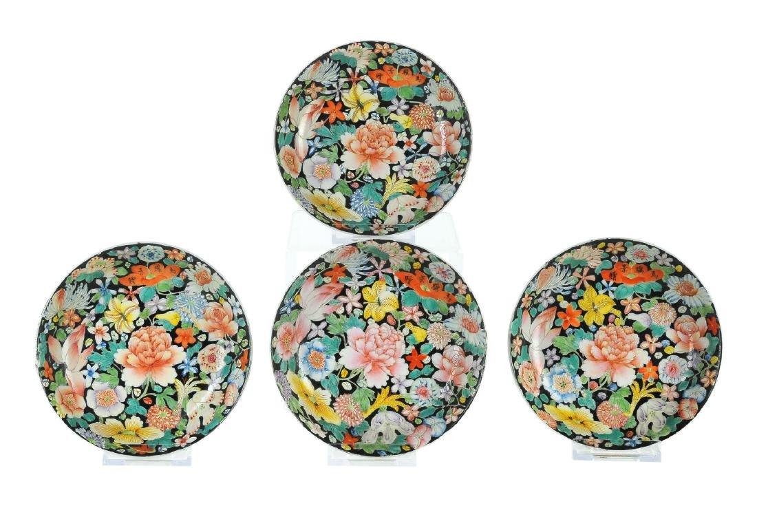 A set of four Mille Fleurs porcelain saucers. Signed in