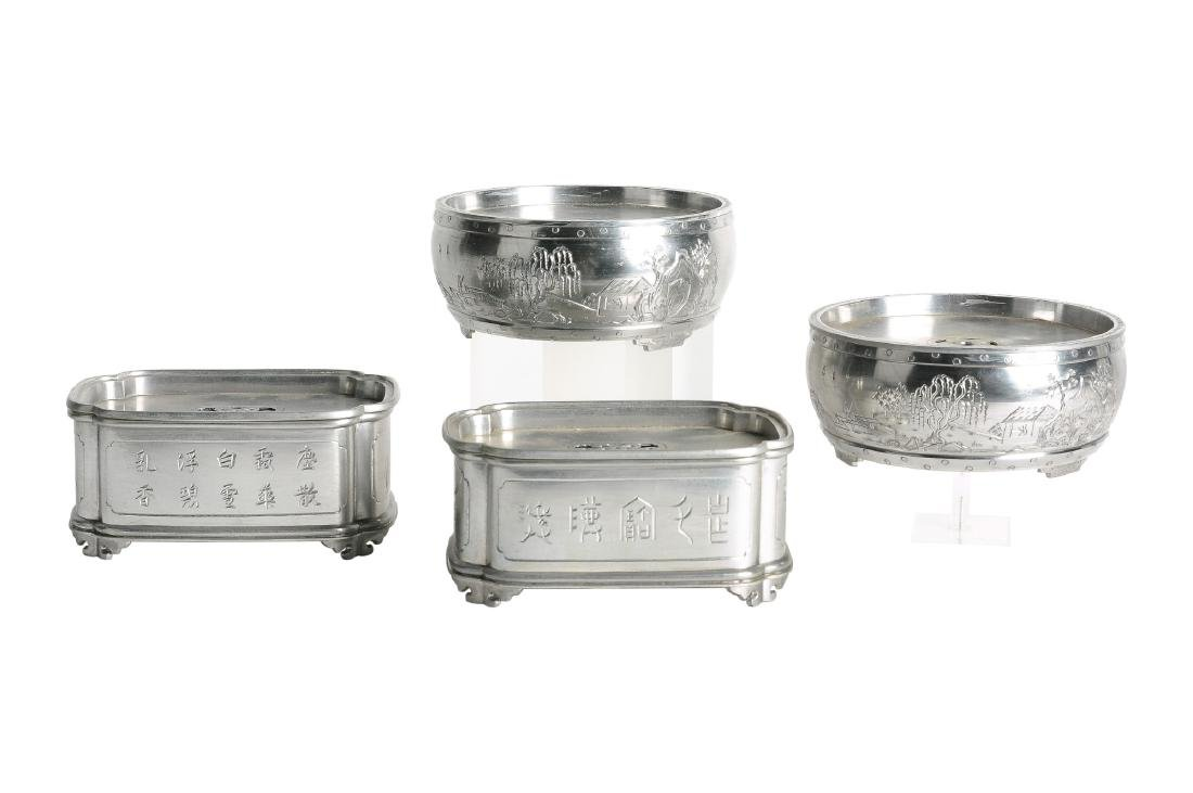 A lot of four pewter water bowls, decorated with