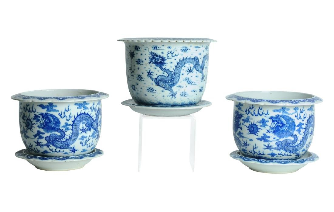 A lot of three blue and white porcelain cachepots with
