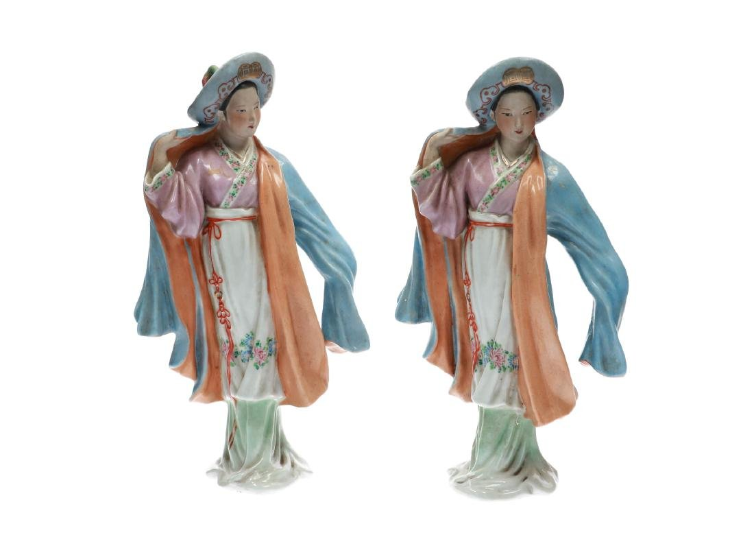 A pair of polychrome porcelain figures, depicting