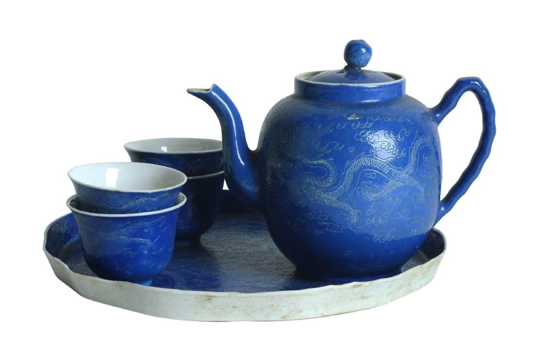 A six-piece blue teaset, including a teapot, four cups