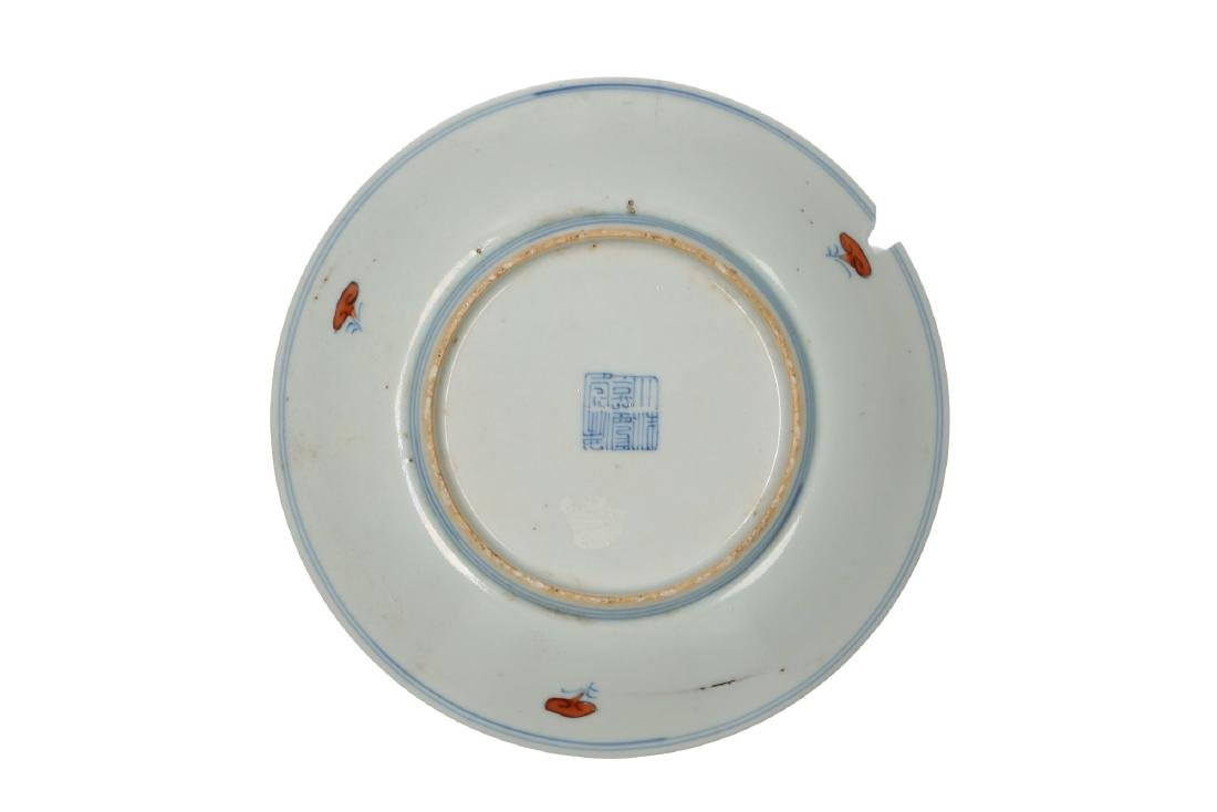 A doucai porcelain plate, decorated with flowers.