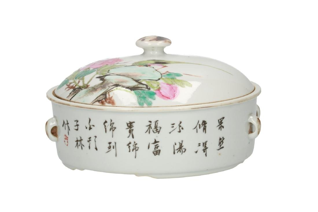 A polychrome porcelain lidded bowl, decorated with